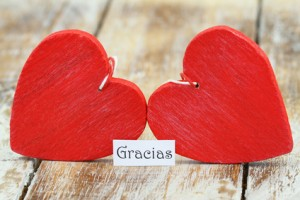 Gracias (thank you in Spanish) with two red wooden hearts
